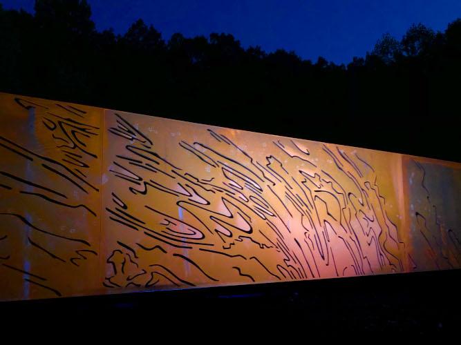 """Ridge & Valley"", a 9' x 67' plasma-cut corten steel | Bower Sculpture Park at Night"