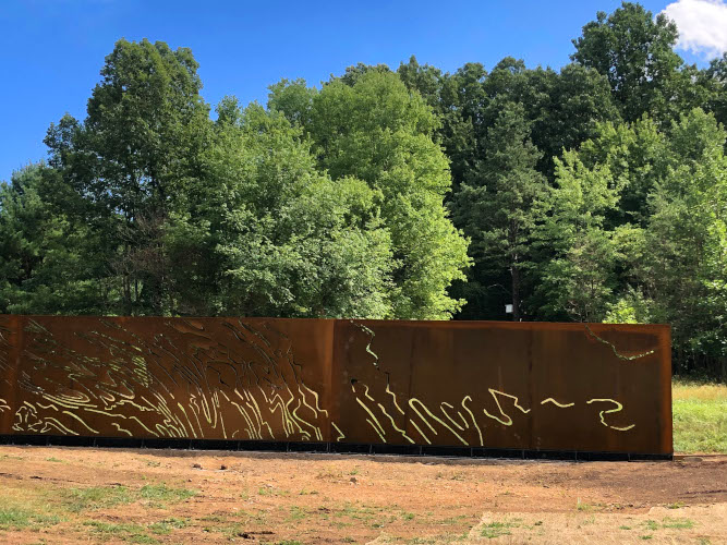"""Ridge & Valley"", a 9' x 67' plasma-cut corten steel | Bower Sculpture Park"